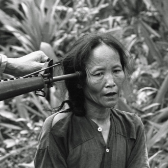 A female Viet Cong suspect 350 miles north of Saigon, on November 1967. The M-16 rifle w. The M-16 rifle w